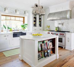 Declutter your counters for a kitchen that's calm, collected, and ready for cooking. Evaluate what you truly use every day and find new homes for the rest. Consider storing small appliances, such as a coffee grinder or toaster, inside cabinets. Try lining up cookbooks on shelves built into an island or located above a small desk. Keep the sink area clear by installing rollout shelves under the sink for handy access to dish-cleaning supplies.