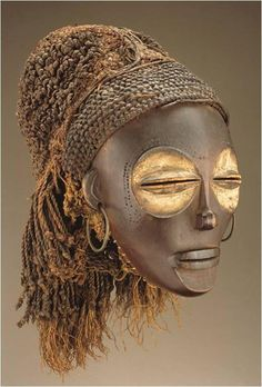 173. Female (Pwo) Mask. Chokwe Peoples (DRC). Late 19th to early 20th century C.E. Wood, fiber, pigment, and metal.