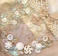 Like the combination of ribbonwork flowers, lace, beadwork, buttons and embroidery! :)