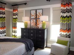 The colorful drapes draw you in and jazz up an otherwise standard bedroom. One love.