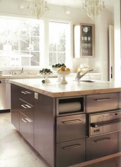 So much great storage in a simple island - paper towel holder, electrical outlet, etc. Frees up counter space. and looks amazing!