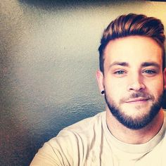 campusbeefcake:  beard, squinty eyes, and spacers in the ears....