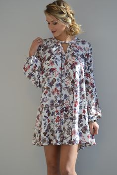 Penelope Floral Boho Dress | Foi Clothing | Beautifully Boho | Must Have | Staff Pick of the Day | New Arrival | We LOVE This Dress | Buttoned Neckline | Floral Patterned | Buy Now at foiclothing.com | Spring Fashion |