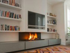 Installing a TV above fireplace is a great way to enjoy to central features. Model 572 TV combines a TV above fireplace in a simple and elegant manner. Tv Above Fireplace, Home Fireplace, Fireplace Remodel, Living Room With Fireplace, Fireplace Modern, Gas Fireplaces, Fireplace Ideas, Bioethanol Fireplace, Black Fireplace