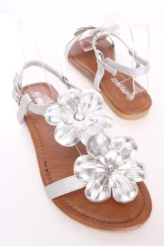 You will be head over heels for these saucy little sandals! They will perfectly compliment any outfit for any occasion! Make sure to add these to your collection, they definitely are a must have! The features include a faux leather, flower accents, open toe, side buckle closure, smooth lining, and cushioned footbed.