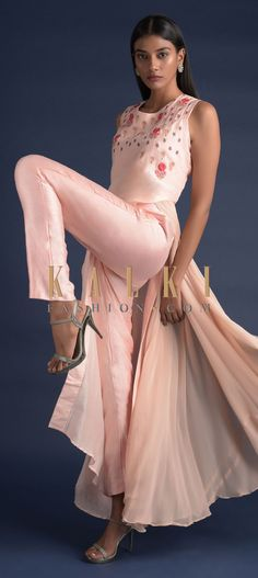 Buy Online from the link below. We ship worldwide (Free Shipping over US$100)  Click Anywhere to Tag Powder Peach A Line Suit With Asymmetric Hem And Attached Fancy Flared Layer Online - Kalki Fashion Powder peach A line suit in cotton with asymmetric hem and attached fancy flared layer on the side in beige chiffon.Enhanced with resham and zari embroidered floral motifs on the neckline.Crafted sleeveless with round neckline.