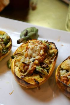 Stuffed Spaghetti Squash with Caramelized Brussels sprouts Manchengo Cheese and A Roasted Pepper Sauce - Vegetarian - Grain Free - Nut Free - Gluten Free Vegan Recipes, Cooking Recipes, Fall Recipes, Delicious Recipes, Holiday Recipes, Red Pepper Sauce, Vegan Dinners, Easy Dinners, Stuffed Sweet Peppers