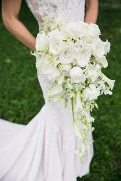 Church Ceremony + Elegant Reception with Silver Details Cascading Bridal Bouquet Photography: L Photographie Read More: www. Lily Bouquet Wedding, Cascading Wedding Bouquets, Bride Bouquets, Bridal Bouquet White, Cascade Bouquet, Rose And Lily Bouquet, Calla Lily Bouquet, Boquet, White Roses Wedding