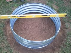 """36""""X 12"""" galvanized fire pit ring $38 at Rural King.River rock -free from local creek bedMortar -$14.58 for 3 bags (we bought 4 but only used 3)Clearing the grass from the spotLeveling the ringWe..."""