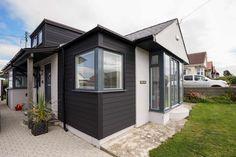 Close up of corner view showing aluminium clad timber corner window with matching aluminium corner post capping.