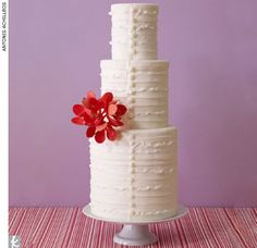 Ruffled white wedding cake accented with sugar buttons and red orchids by Cake Alchemy, CakeAlchemy.com    > Find your wedding cake baker