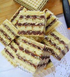 Masa do wafli, którą chcę Wam zaproponować, jest bardzo smaczna, dobrze zastyga, ale też pozostaje lekko wilgotna, dzięki czemu gotowe w... Polish Desserts, Polish Recipes, Condensed Milk Cake, Delicious Desserts, Yummy Food, Arabic Food, Cookies, Sweet Recipes, Sweet Tooth