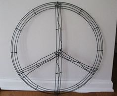 how to make a peace sign ornament wreath!! this would look good with silver ornaments!!!