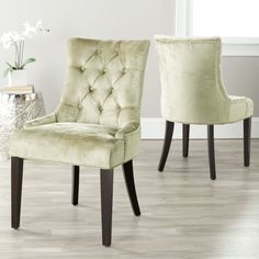 Create an elegant dining room with these modern velvet dining chairs from Marseille. The set of two chairs features solid beechwood frames for added durability, bronze velvet upholstery, and tufted backs that add a sophisticated touch.