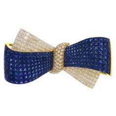 Sapphire Diamond Gold Bow Brooch                                                                                                                                                                                 More