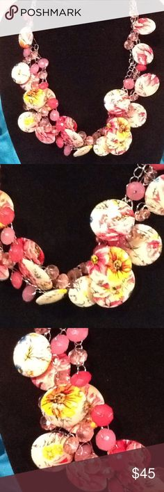 Hand made statement necklace. I call this the Pink Flower Garden. Unique discs with pink, yellow and a touch of blue flowers combined with three different shades of pink crystals.  One of a kind from The Prudence Collection. The Prudence Collection Jewelry Necklaces