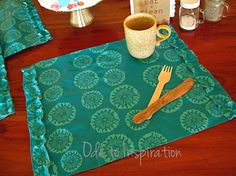 Place mats from a table cloth, but I wonder if my boys wouldn't knock them off the table so that they're now floor mats.