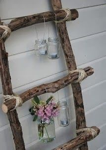 Homemade wood ladder would be great for displaying quilts