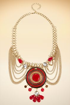 Get ready for attention in this showstopping bib with a dramatic center pendant and tiered gold-tone chains.