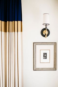 Color-blocked custom drapery in the formal living room offsets monochromatic art purchased during the Millars' travels.