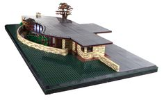 Chris Eyerly built a large version of the Laurent House, designed by Frank Lloyd Wright. The challenging part of the model is the courtyard formed by the curved exterior and stone wall. In addition…
