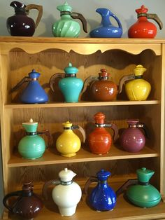 California solid color pottery early coffee jugs.  Represented here in all their glory are the 15 manufacturers.  They are Gladding McBean, Metlox, Garden City, Bauer, Tudor, Joaquin, Hollydale, Cabana, Haldeman, Pacific, Meyers, Vernon Kilns, Sierra, Padre and Catalina.  I know of no other Pre WWII CA pottery company that created coffee carafes.  2 different carafes are shown for Hollydale. They represent each maker like individual finger prints.  At least 3 of these are very hard to find.