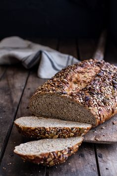 This delicious Seeded Whole Grain Breakfast Bread is packed with healthy whole grains, oatmeal, flax and seeds. Find this and more at halfbakedharvest.com