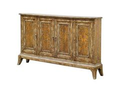 Shop for Uttermost Maguire 4 Door Cabinet, 25601, and other Living Room Cabinets Made from plantation-grown mango wood with honey-stained mindi veneer, hand painted in warm oatmeal with heavy distressing. Two adjustable shelves per side.
