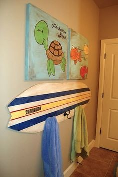 Turn that Surf Board into a Towel Rack -- so cute!
