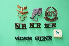 Nigeria Regiment Shoulder Titles x 5 with lugs. with- Unknown Elephant Badge with lugs. with- Biafran Army badge.   eBay!