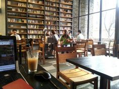 cafe comma korea: rather than throwing away non-current books, patrons read them and buy them at off while enjoying coffee- great idea Bookstore Design, Library Design, Library Cafe, London Cafe, Coffee Shop Interior Design, Cozy Cafe, Cafe Shop, Books, Libraries