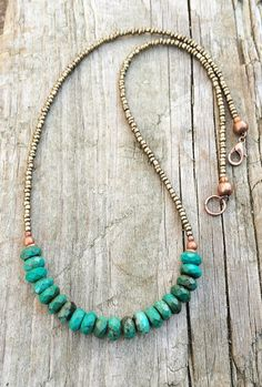 """Brilliant blue green genuine, faceted turquoise rondelles with matte bronze seed beads and copper accents. Approx 18"""" in length."""