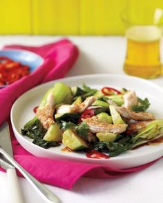 Here's a dish that blurs the line between salad and stir-fry: sesame-crusted chicken and bok choy tossed in a tart ginger-soy vinaigrette and served on a bed of cucumbers.