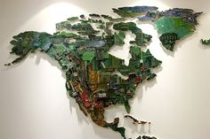 world map made out of motherboards, electrical wiring, fans, and other components