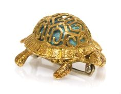 An 18 Karat Yellow Gold and Turquoise Turtle Pin, Italian, in a textured openwork design over a central oval cabochon cut turquoise, pin measures approximately 36.00 x 20.00 mm.