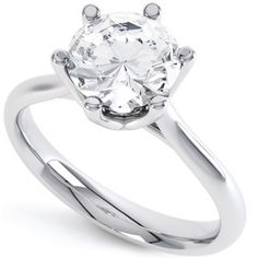 Tiffany Inspired Solitaire Engagement Ring. Crafted in 950 Platinum and set with a modern round brilliant cut 0.50cts diamond. J colour and SI2 clarity. Ready made and ready to wear from Serendipity Diamonds.