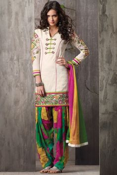 Charismatic cream cotton salwar kameez set. Kameez is adorned with patch work, stone, flower print and resham.