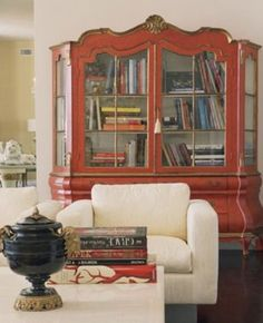 fab italian painted china cabinet used as a bookcase.