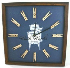 """Wash Works Wall Clock This wooden clock features wooden clothes pins at each number spot. It is a very detailed with a vintage look. It runs on a AA battery. It measures 12"""" x 12"""" x 1.5"""". Brand New"""