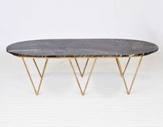 I love these brass triangular legs...maybe I could DIY it?      Surf Gold Leaf Coffee Table- Black Marble  http://www.claytongrayhome.com/item.php?item_id=3044_id=52#