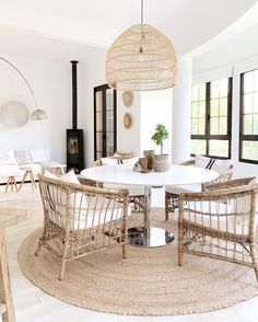 A relaxed white and rattan open plan dining room and living room – contemporary Mediterranean style my scandinavian home: Step Inside A Relaxed Finnish Oasis in Mallorca Home Interior, Interior Design, Interior Colors, Interior Modern, Interior Ideas, Interior Inspiration, Round Marble Table, White Round Dining Table, Rattan Lamp