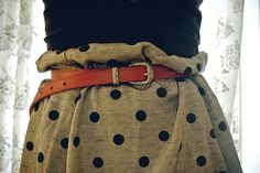 I love muted colours with spots and an old leather belt. Great combo.