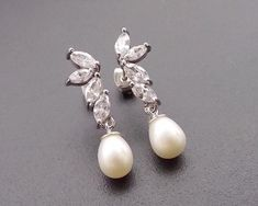 Such a classically beautiful bridal earring and will add that touch of luxurious glamour to your wedding day look with it's understated sterling silver finish. Teardrop Pearl Earrings, Pearl Earrings Wedding, Bridal Earrings, Boho Earrings, Silver Earrings, Ivory Pearl, Silver Pearls, Designer Earrings, Ear Piercings