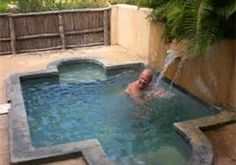 Simple plunge pool you could build yourself. Visit www.custombuiltspas.com and review the DIY info offered.