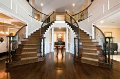 Traditional Staircase with Hardwood floors, Carpet, Double staircase, High ceiling