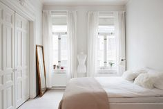 Via homepolish. Feminine and minimalist bedroom from Golden White Decor. Get the look!