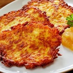 Traditional Kartoffelpuffer (German Potato Pancakes) - The Daring Gourmet Called by different names in Germany's various regions, Kartoffelpuffer are a quintessential and favorite German treat. Easy to make, these potato pancakes taste incredible! Vegetable Recipes, Vegetarian Recipes, Cooking Recipes, German Food Recipes, German Potato Recipes, Cooking Pasta, Potato Pancake Recipes, Potato Rosti Recipe, Pierogi Recipe