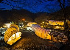 Glamping tents shaped like worms and doughnuts by ArchiWorkshop
