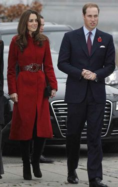 Kate in a gorgeous belted red coat <3 Prince William looking handsome by her side.