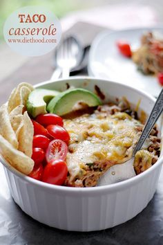 Taco Casserole: Layers of tortillas filled with a mixture of ground beef, spinach, tomatoes and cheeses.